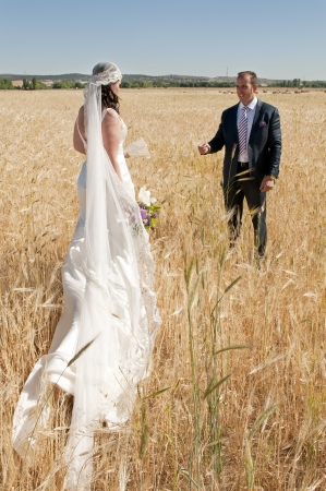 Beautiful bride and loving groom on their wedding day photo