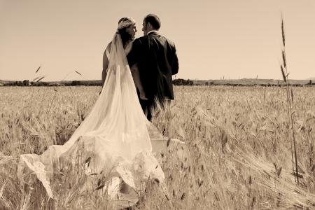 Beautiful bride and loving groom on their wedding day Standard-Bild