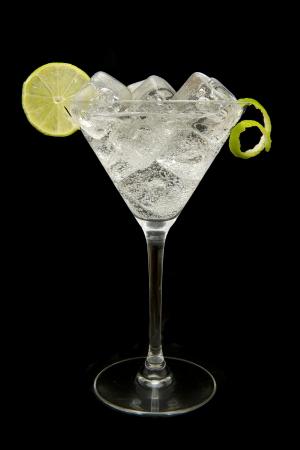 gin: refreshing gin tonic on black background Stock Photo