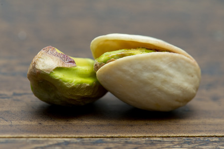 pistachios: pistachios on wooden table