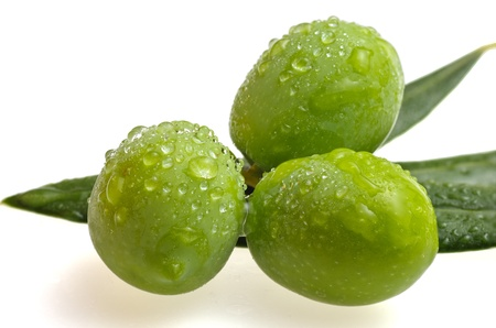 trio of olives on white background Stock Photo