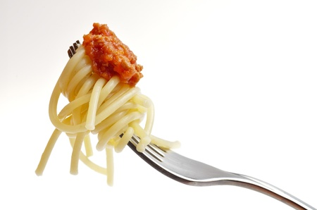 eating spaghetti bolognese isolated on a white background