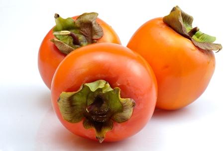 ebenaceae: three newly khakis collected on white background Stock Photo