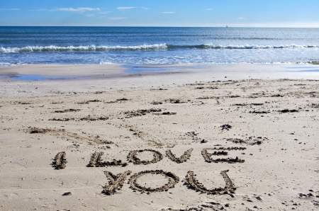 declaration of love in the beach sand photo