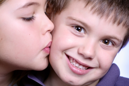 portrait of girl kissing boy photo
