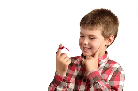 not to forget: child with a red bow on finger to not forget things