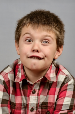 child making ugly faces Stock Photo - 17191421