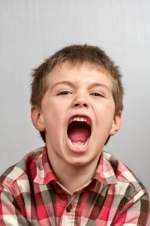 child making ugly faces   photo