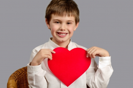 studio photography of a child with a heart of Valentine Stock Photo