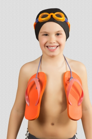 swim mask:   a child with cap and snorkel in gray Stock Photo