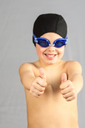 a child with cap and snorkel in gray Stock Photo