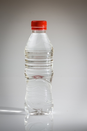 reprocessing: photograph of a bottle of water on white background Stock Photo