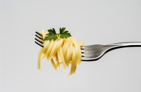 photograph of a fork with spaghetti on white background Stock Photo