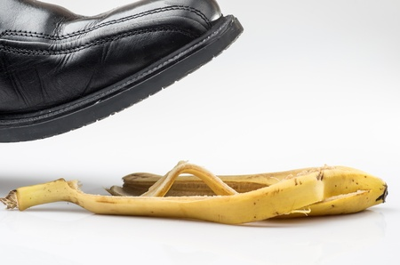 photograph of a shoe before slipping on a banana peel on the floor