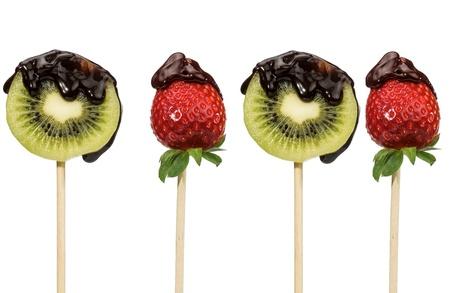 fresh fruit sprinkled with chocolate on black background Stock Photo