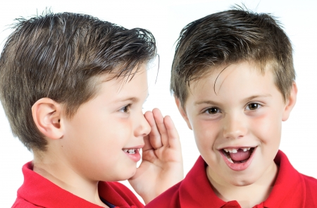 photographic portrait of two children whispering in your ear photo