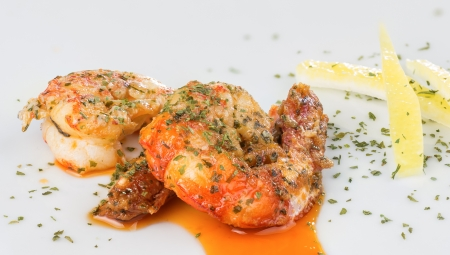macro photograph of a prawn dish decorated with lemon photo