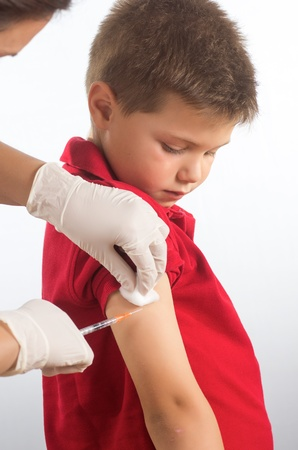a doctor vaccinating a child