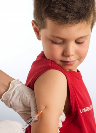 a doctor vaccinating a child photo