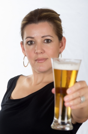 portrait of a woman drinking beer on white background Stock Photo