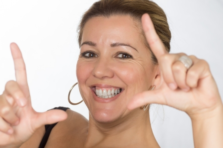 real woman framing itself for photo on white background
