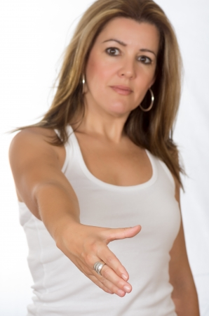 Real woman making the gesture of shaking hands on white background photo