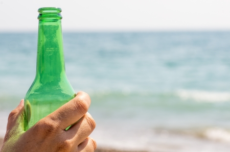 macro photography of a beer with a beach background photo