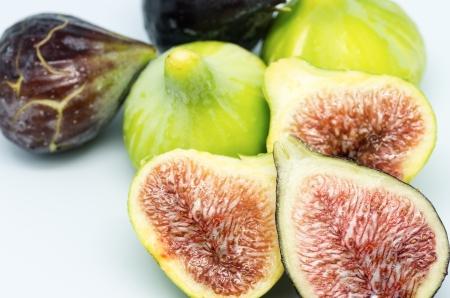 exotism: fig macro photography recently collected on white background Stock Photo