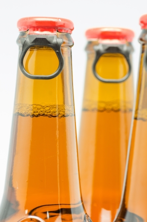 macro photograph of bottles of beer on white background photo
