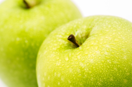 macro photography of a green apple on white background photo