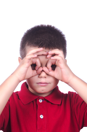child hands making a mask on white background photo