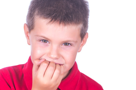 Nail biting child on white background Stock Photo