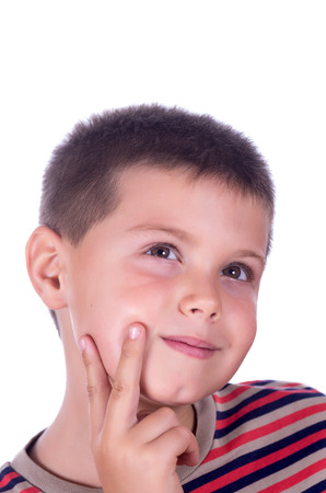 photograph of a pensive boy on a white background photo