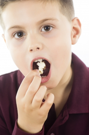 photographic portrait of a boy eating some delicious popcorn photo