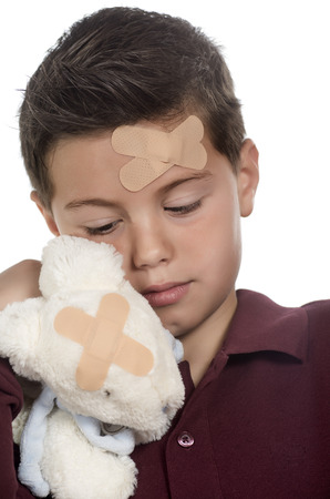 photographic portrait of a boy with sun stuffed bunny both injured