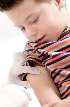 vaccinating: macro photograph of a doctor vaccinating a child