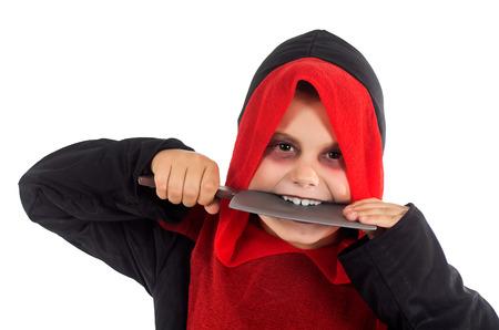 studio photography of a child dressed to enjoy Halloween photo