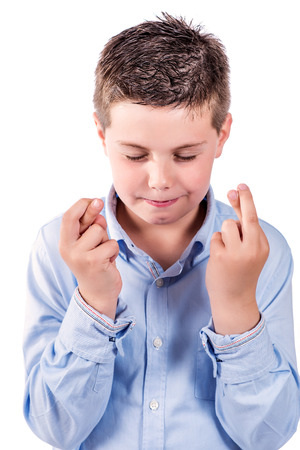 portrait photograph of a child fingers crossed on a white background Stock Photo