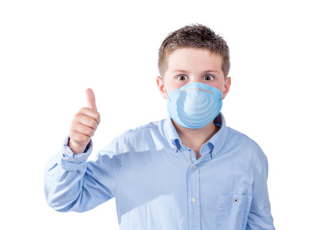 photography portrait of a boy with a face mask to avoid spreading their illness on a white background