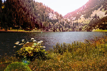 evoke: photograph of a lake between mountains evoke tranquility, relaxation and solitude.