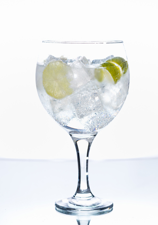 Photographs of a gin tonic with lemon isolated on white background