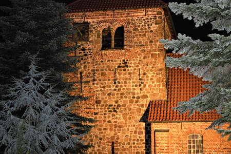Church tower with evening lighting with fir trees in the foreground Banco de Imagens - 152481607