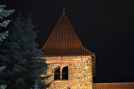 Church with evening lighting with fir trees in the foreground Banco de Imagens - 152481608