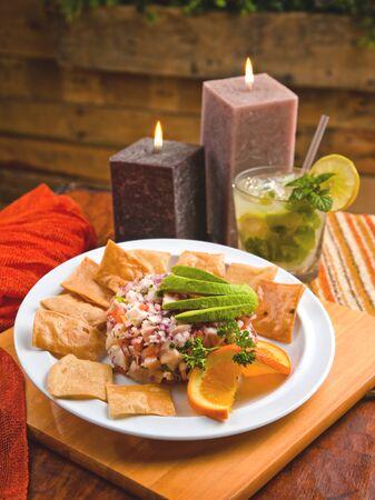 Fish ceviche with avocado, tortilla chips and a mojito 스톡 콘텐츠