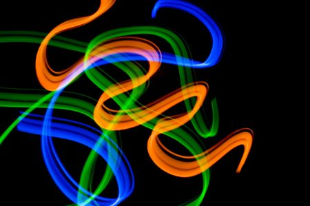 some colrful LED lights in motion resembling ribbons Stock Photo