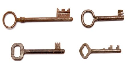 four rusty antique keys over white background