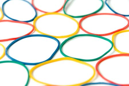 assorted of colorful rubber bands over white Stock Photo