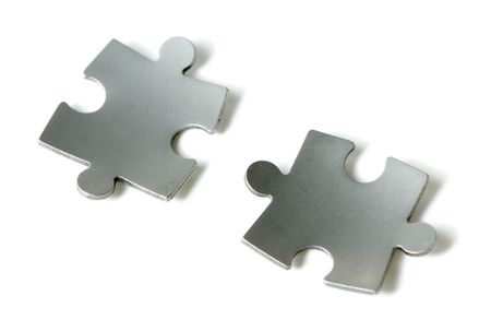couple of bent puzzle pieces over white Stock Photo