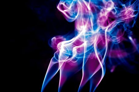 turbulent: blue and pink smoke against black background