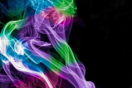 colorful shot of smoke against black background photo